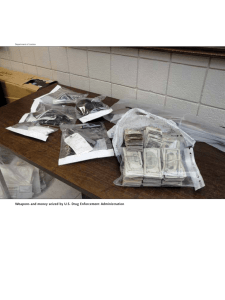 Weapons and money seized by u.S. Drug Enforcement Administration